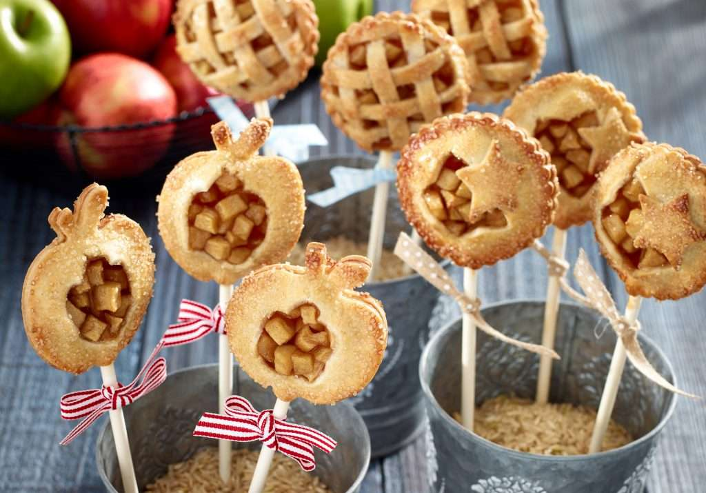 Miso Apple Pie Pops Setting in buckets with apple background